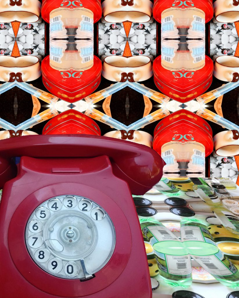 Photo of rotary telephone with highly patterned wallpaper behind and highly patterned tablecloth beneath.