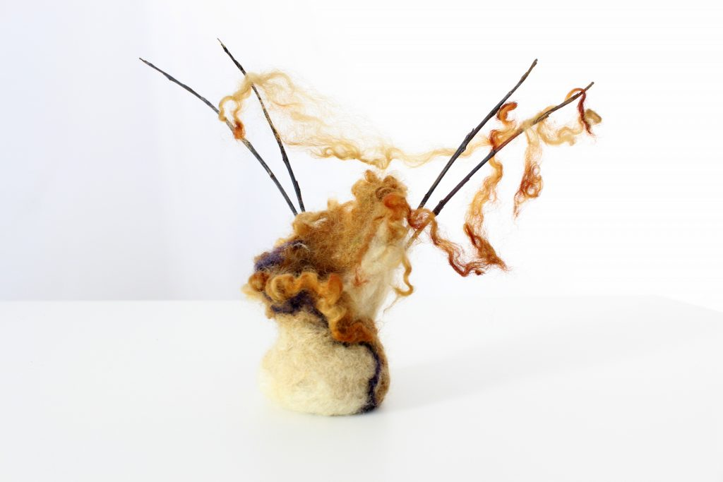 Rust-dyed Felt vessel with twigs